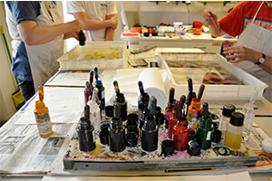 Students preparing for paper marbling with inks on water - TEC Bookbinding and Decorative Papermaking course